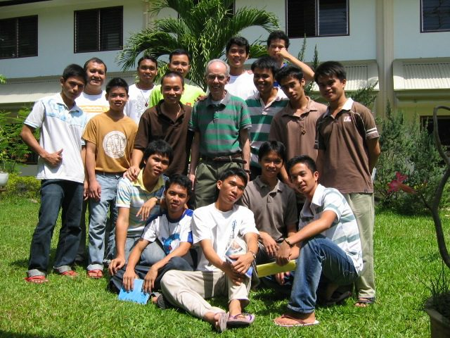 Fr. P.J. McGuire (middle) with students at the 2009 final vows program in the Philippines.