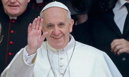 Pope Francis waves to well-wishers. The photo is from the Guardian at the following link: http://www.guardian.co.uk/world/2013/mar/14/pope-francis-doctrine-emphasis-poverty