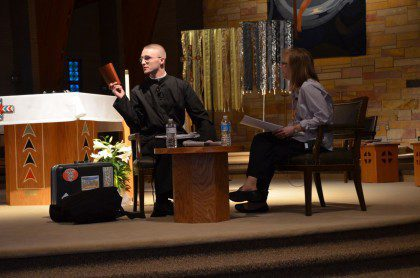"""Justin Krenke, a third-year candidate, """"channels"""" Fr. Dehon during the opening session of Mission Education"""