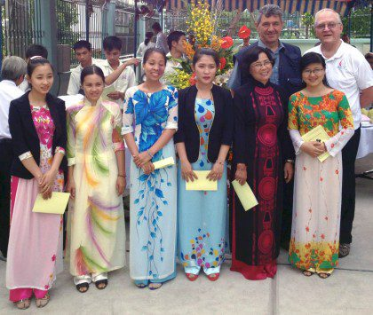 Fr. Bernie with teachers during a visit to the Vietnamese District