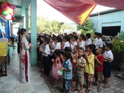 One of the teachers addresses the students during the ceremony