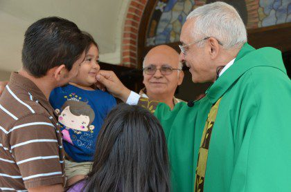 Fr. Ornelas visits with parishioners at Our Lady of Guadalupe