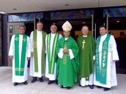 Bishop Vincent Nguyen, auxiliary bishop of Toronto, with Fr. José Ornelas Carvalho, Fr. John van den Hengel and the newly installed parish team of St. Thomas More parish.