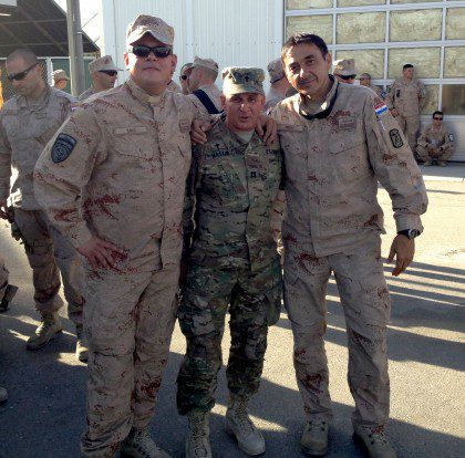 Fr. Mark (middle) with fellow soldiers