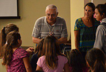 Fr. José Ornelas Carvalho speaks with students at St. Joseph's Indian School. Today he and Fr. John van den Hengel began their visitation of the United States in South Dakota
