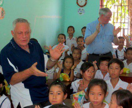 Fr. Rino and Fr. John with students at Huong Tam