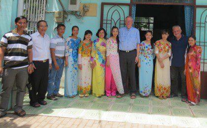 Fr. John van den Hengel and Fr. Rino Venturin with staff at Huong Tam School in Vietnam