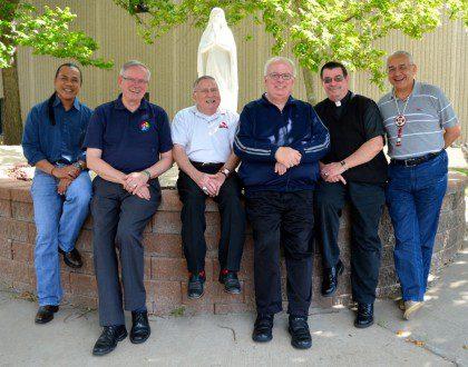 Fr. Ornelas and Fr. John with SCJs in South Dakota