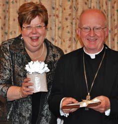 SHST board chair Mary Meehan presents the 2013 Archbishop Cousins Award to bishop Vann