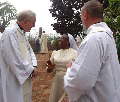 Fr. Jan de Jong and Fr. Byron Haaland talk with one of the religious sisters from Cameroon.