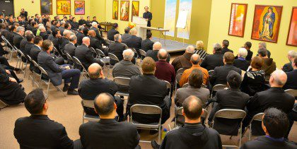 The conference room was packed to standing room only for Fr. Quang's lecture.