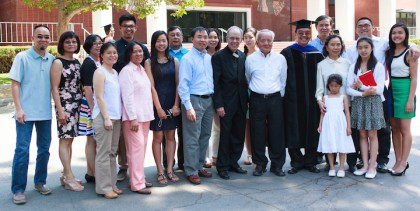 Fr. Quang with family and friends. Fr. PJ McGuire joined them for the graduation ceremony.