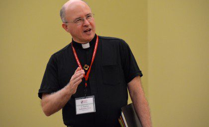 Fr. Stephen Hufstetter talks to the group, noting the North American Continental Conference and the Provincial Chapter cited youth outreach as a priority.