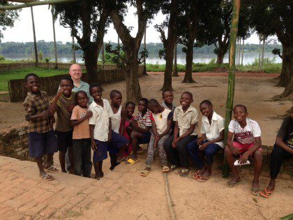 Fr. Steve with children in Congo.
