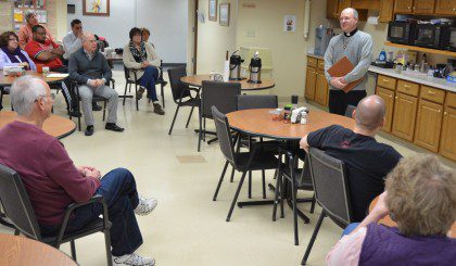 Fr. Steve speaks about Fr. Dehon with employees at the Province Development Office