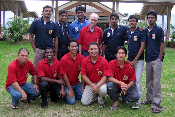 Fr. PJ and students in Asia