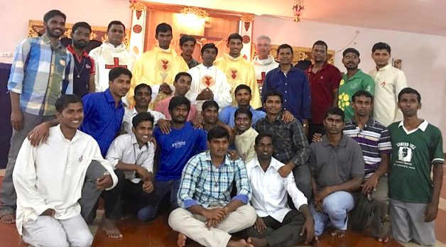 Newly ordained SCJs visit with one of the Indian formation communities