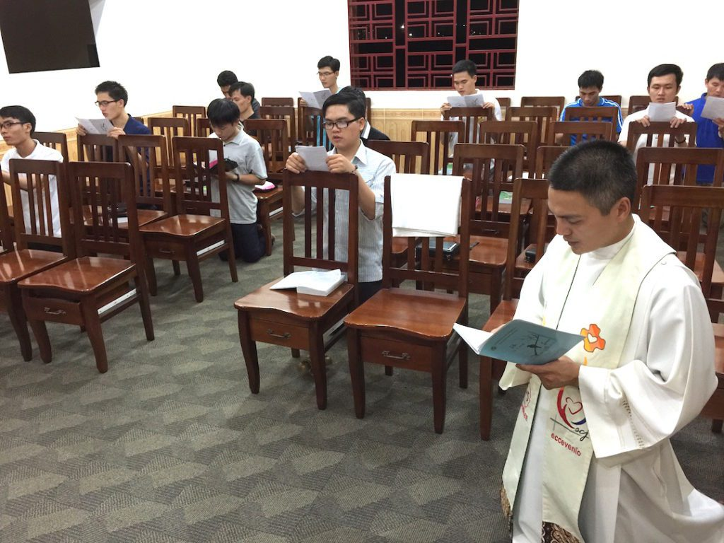 Fr. Francis leads prayer with students in Vietnam