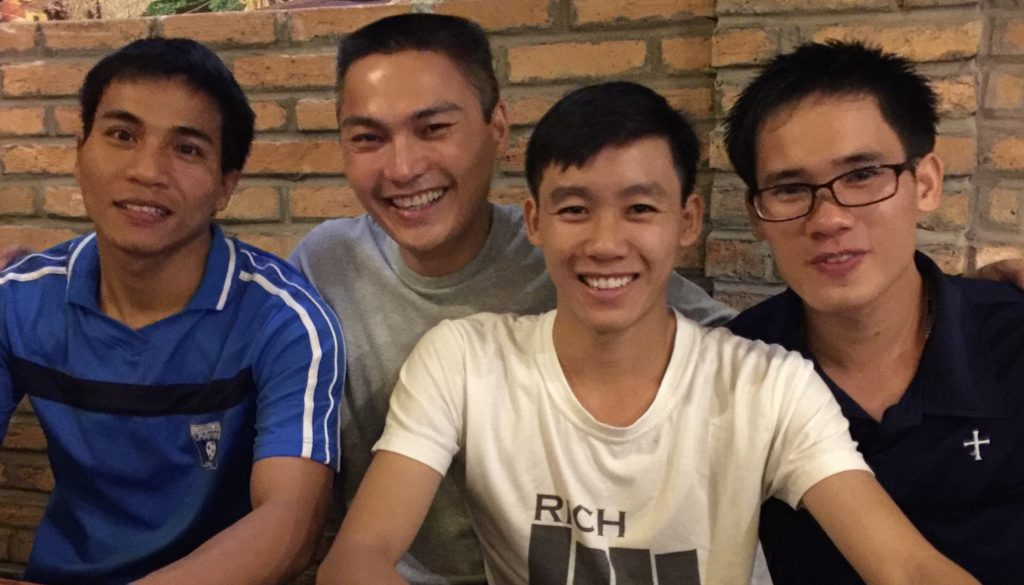 """Fr. Francis (second from left) in a """"selfie"""" with students in Vietnam earlier this year"""