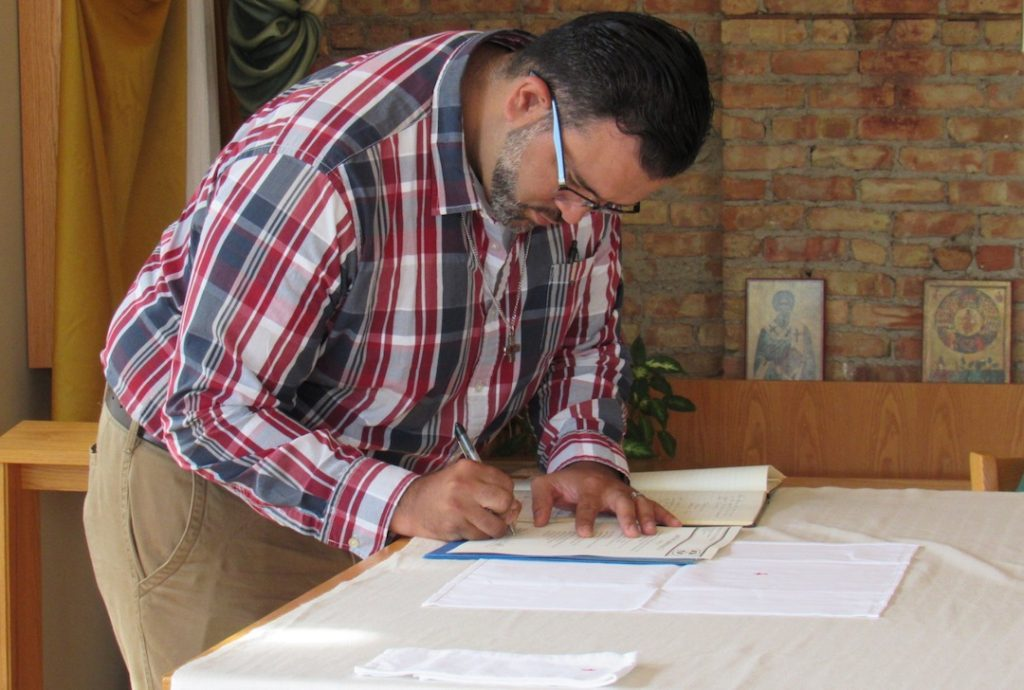 Frater Juancho signs his vow renewal
