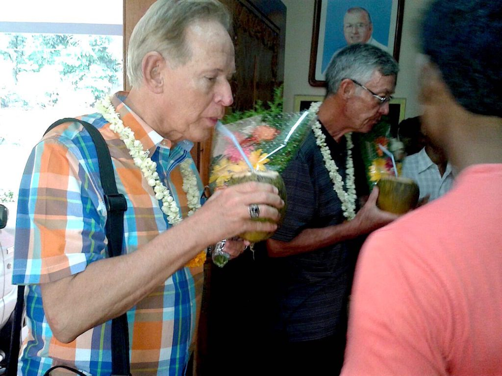 Fr. Jim and Fr. Tom are welcomed with flowers and coconut milk in India